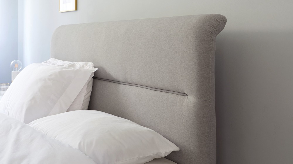 piped headboard king size storage bed