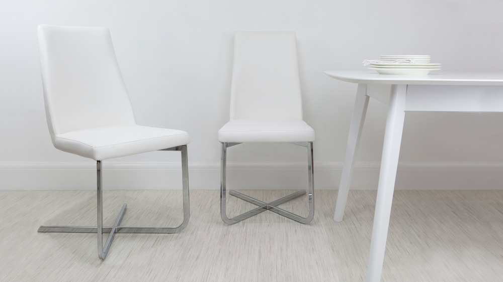 white faux leather cantilever dining chair