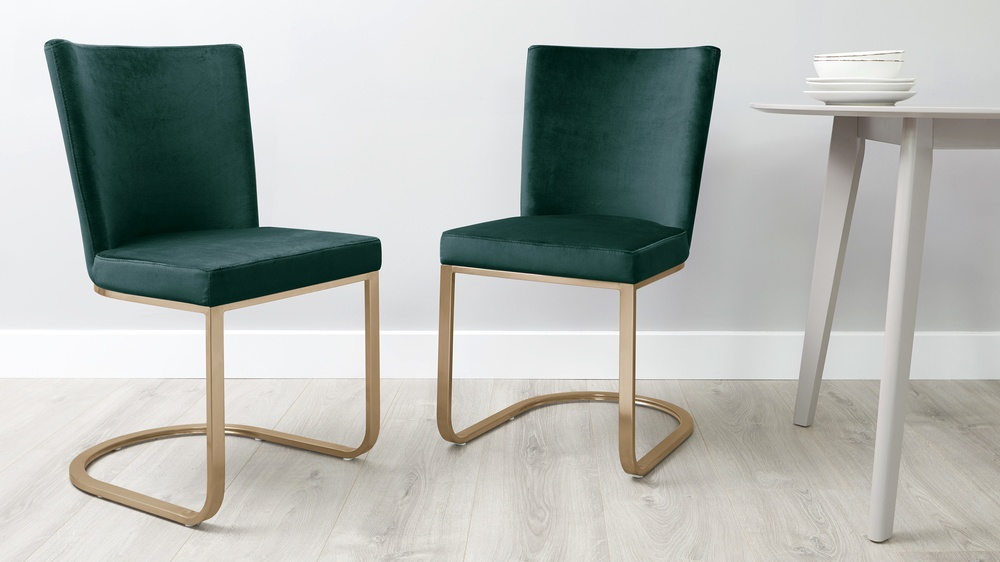 fern green and brass dining chairs