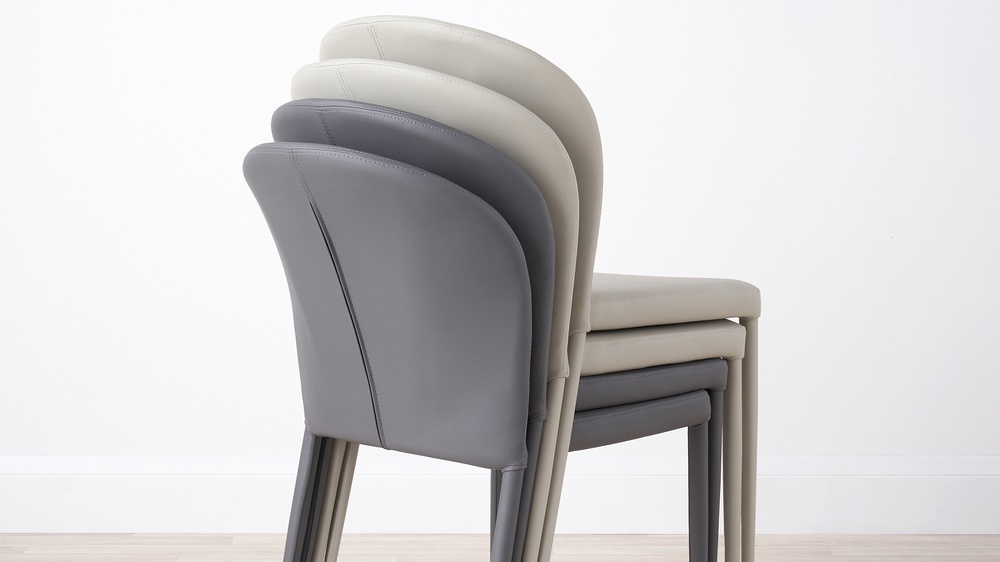 Stacking faux leather dining chairs