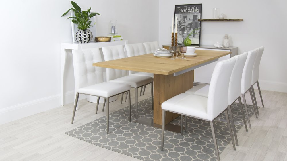 Large Wooden Extending Dining Table and White Chairs
