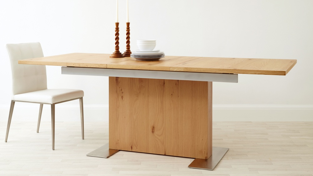 Pedestal 4 to 8 seater dining table with oak veneer finish