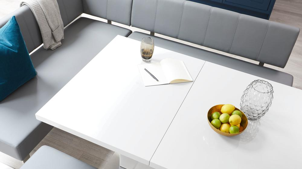 White gloss extending dining table set with corner bench