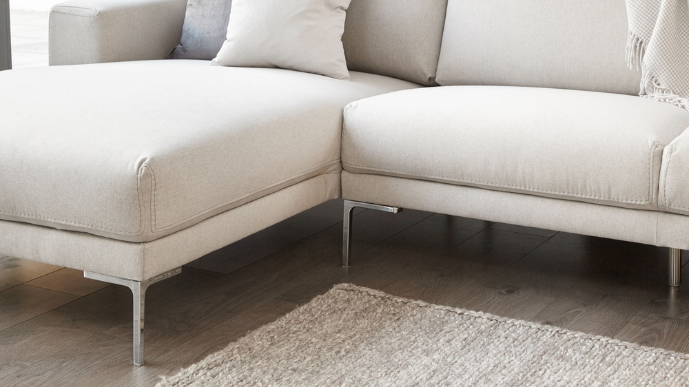 Corner sofa with chrome feet
