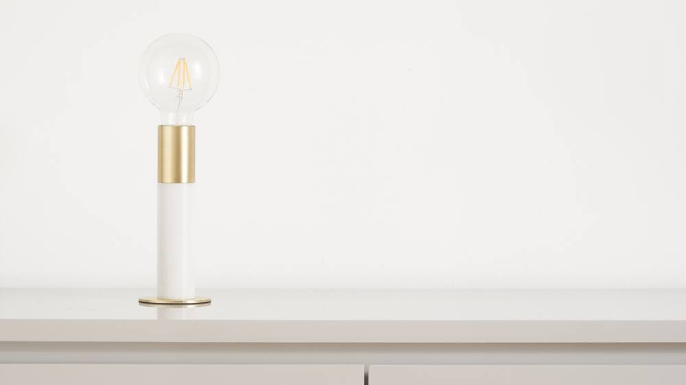 Small white marble and brass light
