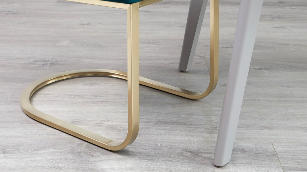 Brushed brass chairs