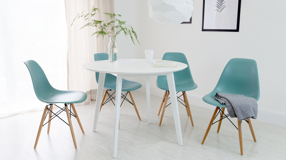 White Dining Table And Eames Chairs