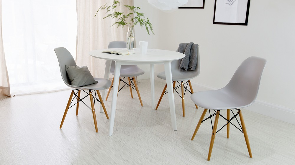 White Dining Table And Grey Eames Chairs