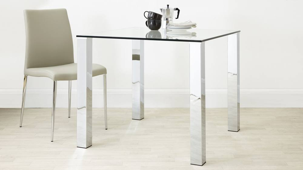modern glass and chrome table seating two to four people
