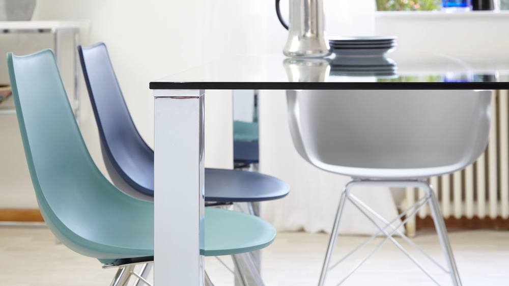 Modern glass and chrome family dining table