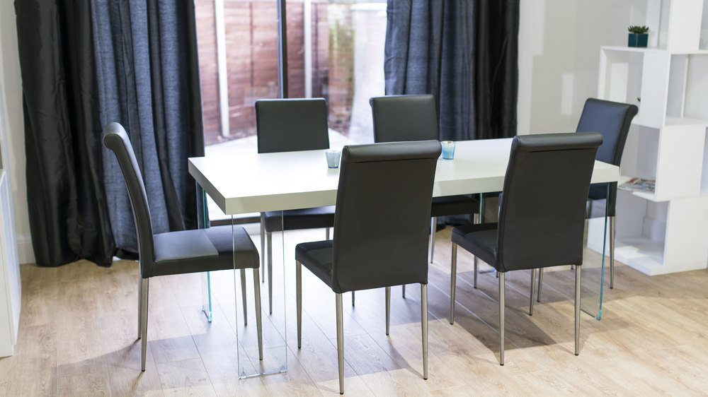 Black Real Leather Chairs and Grey Dining Table