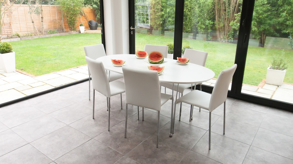 White Oval Dining Table and Modern Dining Chairs