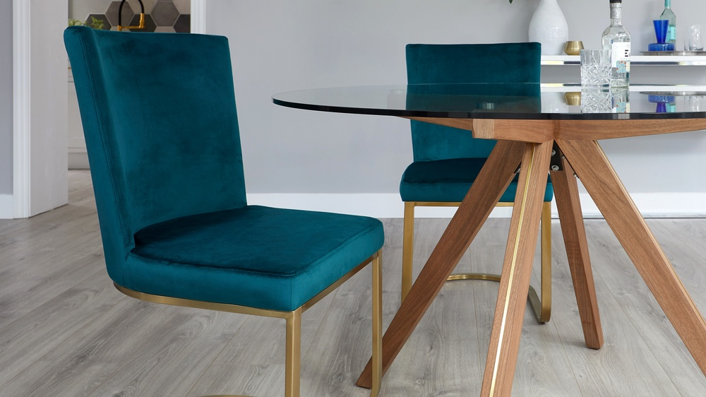 Teal velvet dining chairs with brass leg