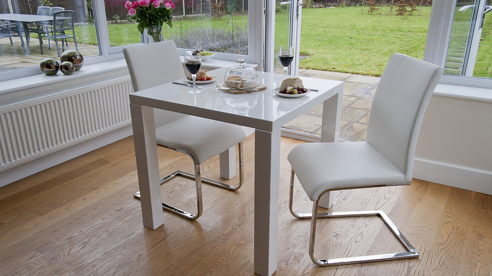 Stylish White Leather and Chrome Cantilever Dining Chairs