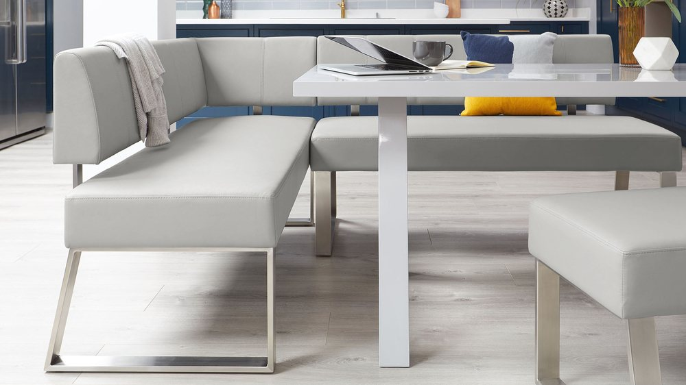 Large light grey kitchen bench with angled leg