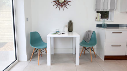 Contemporary White Gloss and Eames 2 Seater Dining Set